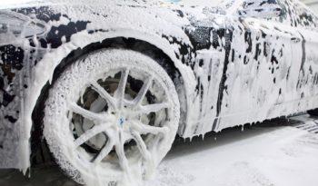 Close up detail of wash cleaning brush on car at carwash